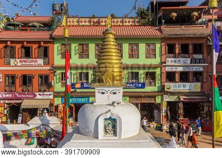 Kathmandu, Nepal - November 14, 2019: Boudhanath Stupa In Front Of Colorful Houses In Kathmandu, Nep