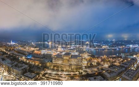 Drone photo, panorama of buda castle and Danube Budapest, Hungary. Snow and winter.