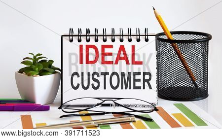 Notebook With Tools And Notes With Text Ideal Customer, Business