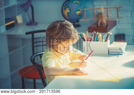 Little Boy Drawing In Room, Education And Daycare.
