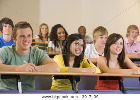 Students In Class Paying Attention And Taking Notes (Depth Of Field)