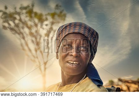 portrait of an old African woman at sunset in her village in Botswana