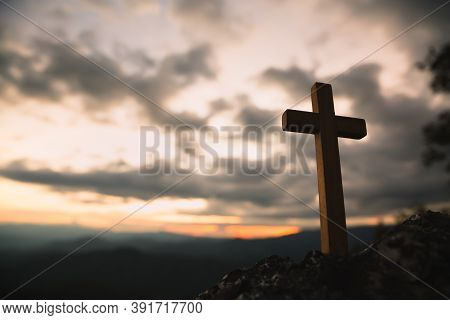 Religious Concepts. Christian Wooden Cross On A Background With Dramatic Lighting,  Jesus Christ Cro