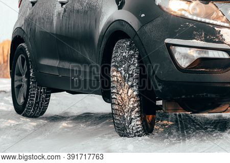 Rubber Winter Wheels In Cold Snowy Weather On Slippery Road. Danger Of Skidding Or Accidents When Dr