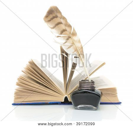 Pen, Ink And A Book On A White Background