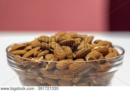 Closeup Raw Peeled Almonds In Glass Bowl, Macro Shot Of Organic Fresh Tasty Nuts, Natural Delicious