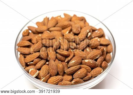 Closeup Raw Peeled Almonds In Glass Bowl On White Background, Organic Fresh Nuts, Natural Delicious