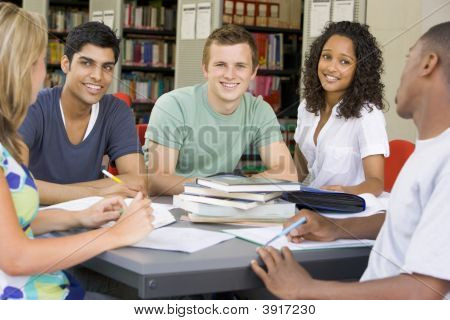 Five People In Library Studying (Selective Focus)