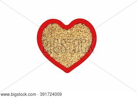 Brown Rice Groats In Heart Shape Red Frame Isolated On White Background