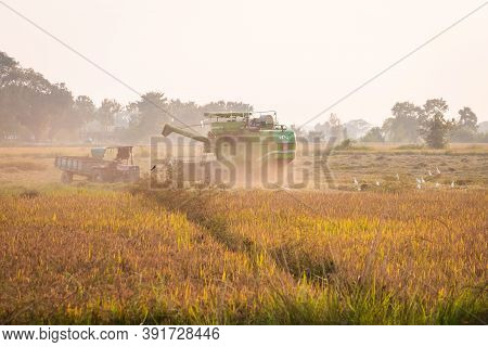 Bhairahawa, Nepal - October 26 2020: Harvesting Rice Using Combine Harvester In Flatlands Of Nepal.