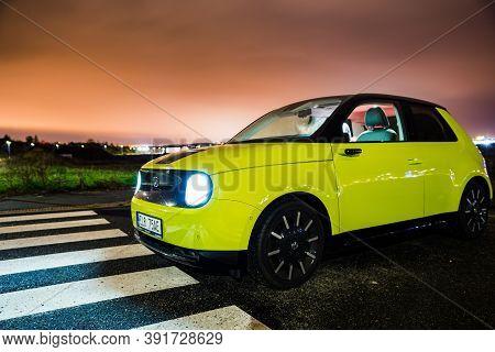 Prague, Czech Republic - October 26, 2020. Night Photo Of Yellow-green Electric Honda E With Interio