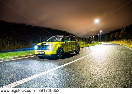 Prague, Czech Republic - October 26, 2020. Night Photo Of Yellow-green Honda E