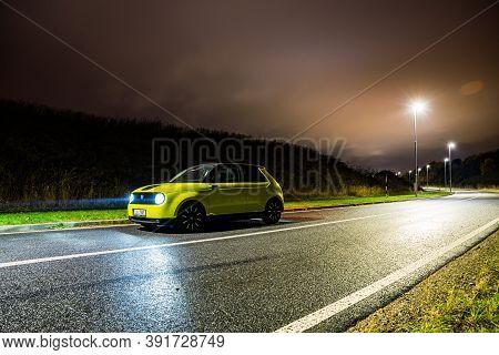 Prague, Czech Republic - October 26, 2020. Night Photo Of Electric Honda E On The Wet Road