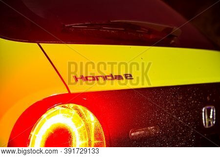 Prague, Czech Republic - October 26, 2020. Night Photo Of Logo Of Honda E On The Back Side Of Car