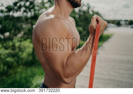 Cropped Shot Of Unrecognizable Muscular Man Has Workout Biceps Exercise Stands In Profile Shows Stro