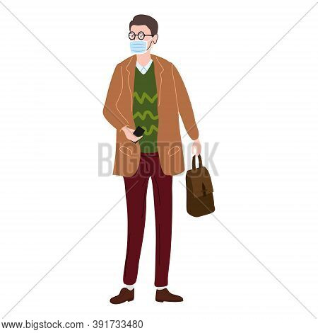 Young Man Student In Modern Autumn Trendy Clothes. In Medical Mask, Individual Protection From Virus