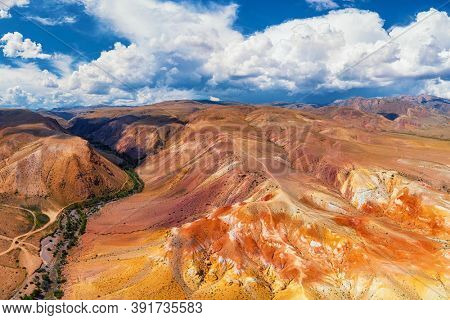Aerial drone panorama of colorful eroded landform of Altai mountains. Nature landscape called Mars, near the border with Mongolia, Chagan-Uzun, Altai Republic, Russia