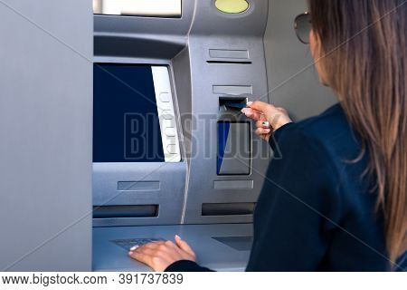 Woman Using An Atm Machine. Withdrawing Cash Money From Credit Or Debit Card At Bank Machine.