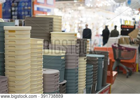 Plastic Crates In A Hardware Store. Automated Storage Warehouse With Blue Plastic Crates. Interior O
