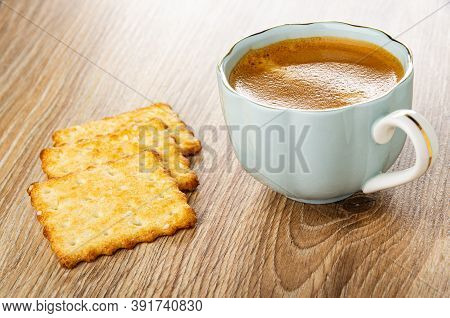 Crunchy Cookies With Sesame, Coffee Espresso In Light-blue Cup On Wooden Table