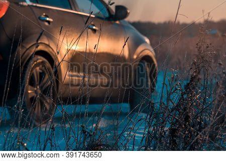Car Stuck In Snowdrift On Slippery Road In Dark Rural Area.