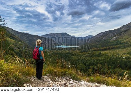 Active Sporty Girl Having A Rest On The Peak Of Alps, Austria. Backpacker Enjoying View Of Mountains