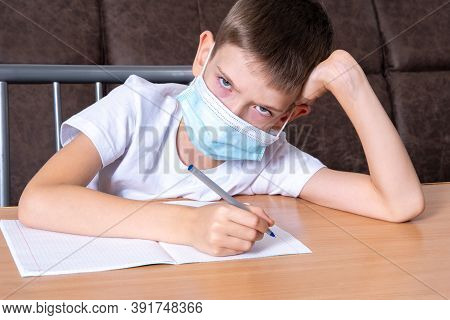 A Boy In A Protective Mask On His Face Looks At You With Displeasure, The Child Does Not Want To Stu