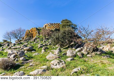 Remains Of Nuraghe Or Fortress From The Bronze Age At Archeological Site Of Tamuli, Sardinia Island,