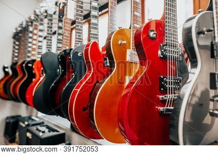 Close Up Of Many Electric Guitars In A Row In The Instrumental Shop, Music Instrument Concept