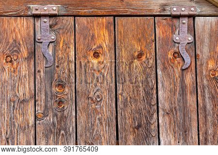 Weathered Wooden Plank Boards With Rusty Hinges