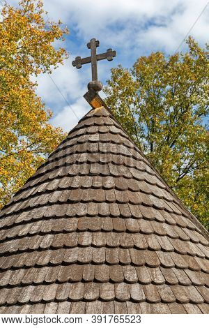 Cross At Top Of Wooden Church Roof