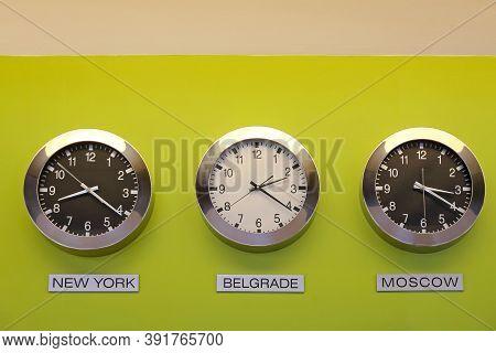 Three Clocks At Wall World Time Business