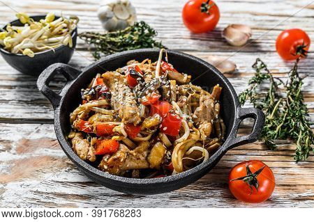 Udon Stir Fry Noodles With Chicken And Vegetables In A Pan. White Background. Top View