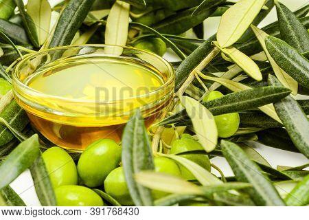 Olive Oil. Glass Transparent Bowl With Extra Virgin Greek Olive Oil Among Olive Leaves And Olives. C