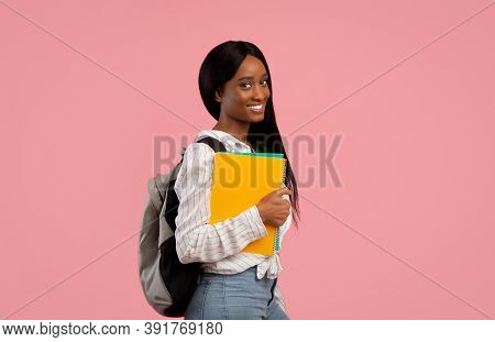 Academic Education. Millennial Black Woman With Backpack And Notebooks Smiling And Looking At Camera
