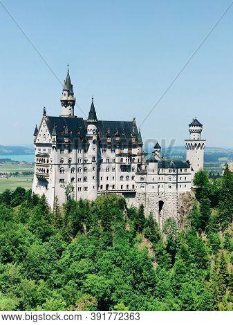 Fussen, Germany - June 27, 2019: Famous Neuschwanstein Castle In The Bavarian Alps. Romanesque Reviv