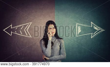 Curious And Doubtful Young Woman, Has To Choose Right Or Left Side. Puzzled Student Girl In Front Of