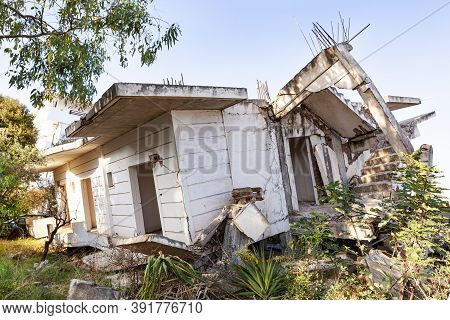 Collapsed House During An Earthquake. Concrete Ruins.