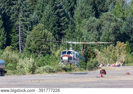 Prospect,  Oregon / Usa - September 9, 2014:  A Fire Fighting Helicopter Takes Off From The Runway W