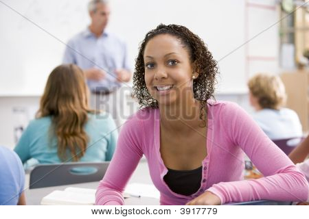 Female student with other students in classroom poster