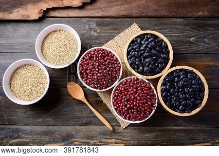 Black Kidney Beans, Azuki Beans And Quinoa Seeds In A Bowl On Wooden Background, Top View