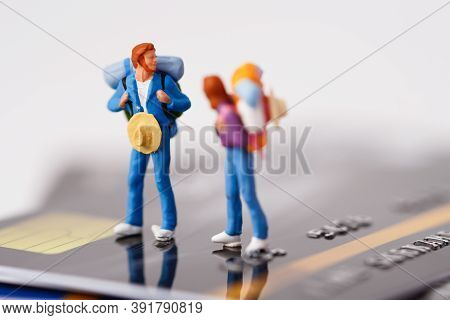 Traveler With Backpack Standing On Stack Of Credit Card, Management Business Finance Transport Trave