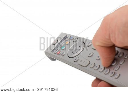 Hand Pressing Silver Remote Control Isolated On White Background. Tv Silver Remote Control In Hand I