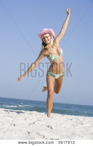 Woman In A Two Piece Bathing Suit Posing On A Beach