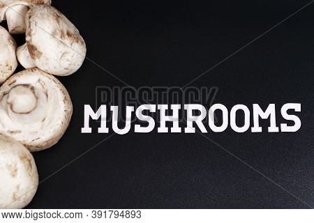 Group Of Champignons. Located On The Left Half Of The Screen. The Inscription On The Right Is Mushro