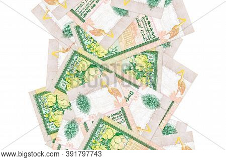 10 Sri Lankan Rupees Bills Flying Down Isolated On White. Many Banknotes Falling With White Copyspac