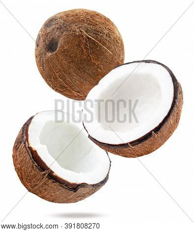 Coconut Whole And Half Falling On A White, Isolated. Levitating Coconut