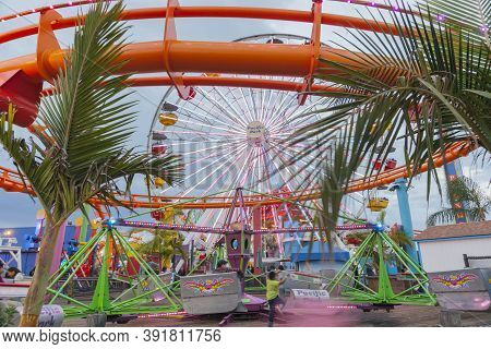 Los Angeles Usa_ October 5 2015; Santa Monica Pier Fairground Attractions And Activities With People