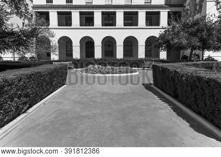 Monochrome Example Of Mediterranean Revival And Spanish Colonial Revival Styles With Arched Portico