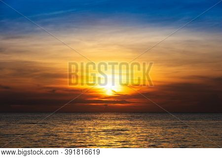 dramatic sunset with clouds over the ocean